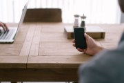 person-smartphone-office-table1